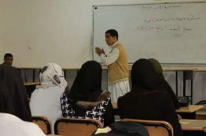 Man lecturing in front of whiteboard